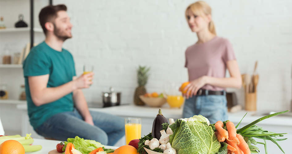 couple in kitchen with detox cleansing drink